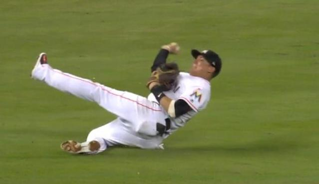 Marlins shortstop Miguel Rojas completed one of the best plays this season with a throw from his backside. (MLB.TV)