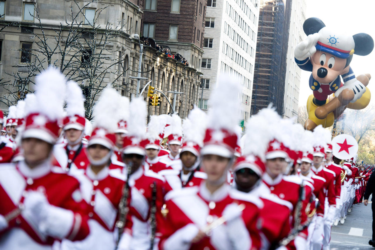 The Sailor Mickey balloon floats in the Macy's Thanksgiving Day Parade in New York, Thursday, Nov. 22, 2012. The American harvest holiday came as portions of the Northeast were still coping with the wake of Superstorm Sandy, and volunteers planned to serve thousands of turkey dinners to people it left homeless or struggling. (AP Photo/Charles Sykes)