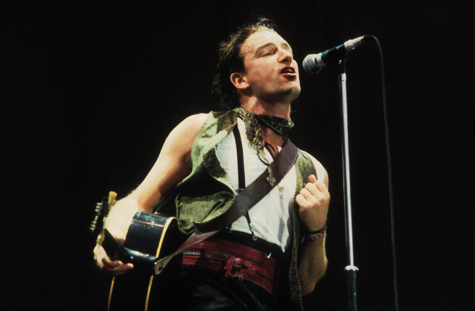 Bono of U2 performs on stage on The Joshua Tree Tour at Feyenoord Stadion, De Kuip, Rotterdam ,Netherlands, 10th July 1987. (Photo by Rob Verhorst/Redferns)