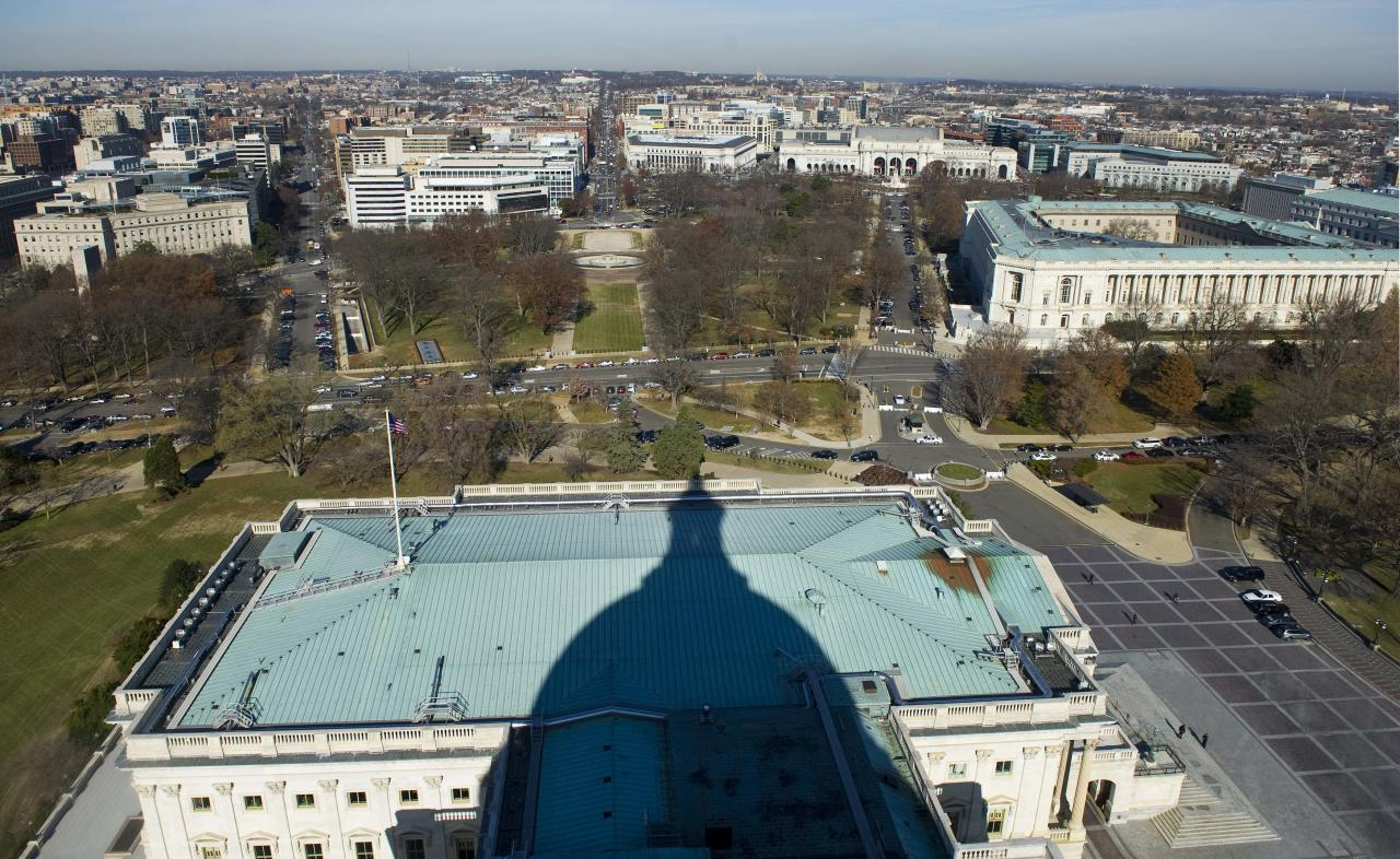 A view north from atop the U.S. Capitol dome shows the Russell Senate Office Building (R) and Union Station (2nd R) during a media tour of the dome on Capitol Hill in Washington, December 19, 2013. The Capitol dome has not undergone a complete restoration since 1959-1960 and due to age and weather the Architect of the Capitol says that it now has more than 1,000 cracks and deficiencies. Americans longing for a makeover in Washington will get their wish partially granted as the dome of the U.S. Capitol - but not the lawmakers who work inside - undergoes a $60 million restoration. To match USA-CAPITOL/DOME REUTERS/Douglas Graham/POOL (UNITED STATES - Tags: POLITICS TRAVEL SOCIETY)