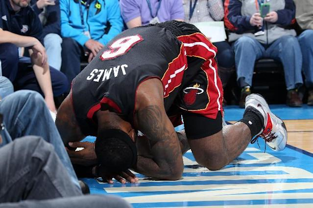 OKLAHOMA CITY, OK - FEBRUARY 20: LeBron James #6 of the Miami Heat lays on the court after being injured against the Oklahoma City Thunder on February 20, 2014 at the Chesapeake Energy Arena in Oklahoma City, Oklahoma. (Photo by Layne Murdoch/NBAE via Getty Images)