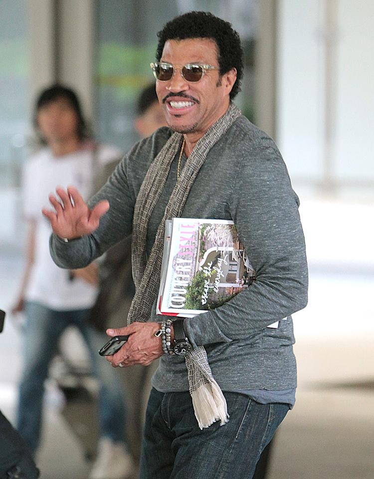 June 19, 2012: The Richie-Madden family are seen arriving at LAX aiport today from Australia where Joel Madden just wrapped 'The Voice'. Pictured here: Lionel Richie.
