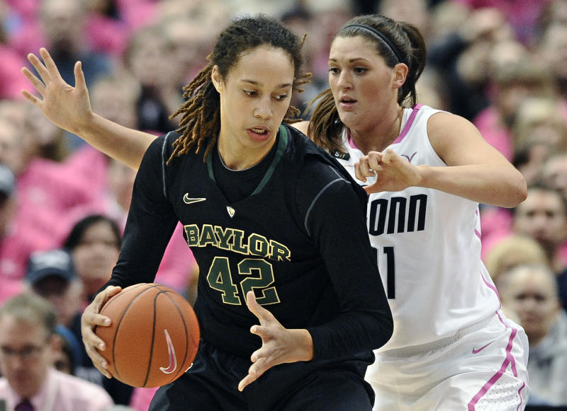 Baylor's Brittney Griner, left, is pressured by Connecticut's Stefanie Dolson during the first half of an NCAA college basketball game in Hartford, Conn., Monday, Feb. 18, 2013. (AP Photo/Jessica Hill)