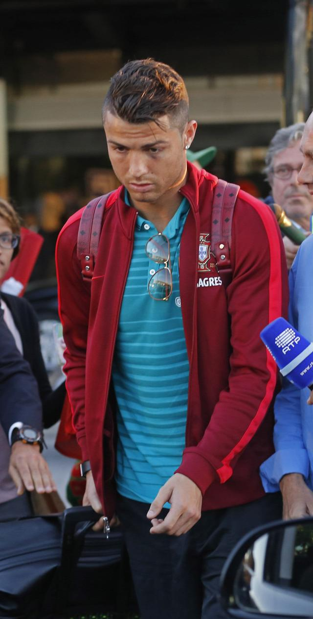 Portugal's Cristiano Ronaldo arrives from the 2014 World Cup in Brazil with the national soccer team, at Lisbon airport June 28, 2014. REUTERS/Hugo Correia (PORTUGAL - Tags: SPORT SOCCER WORLD CUP)