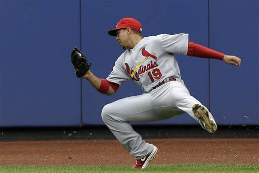 St. Louis Cardinals center fielder Jon Jay (19) fields New York Mets' Jordany Valdespin's sixth-inning flyout near the warning track in a baseball game in New York, Thursday, June 13, 2013. (AP Photo/Kathy Willens)