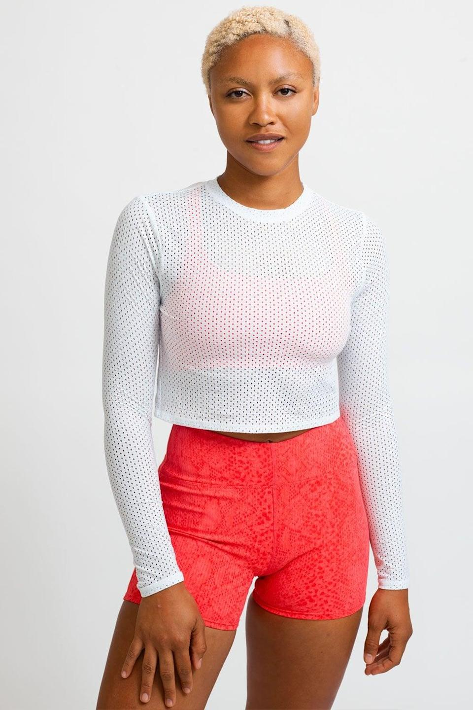 <p>This cute <span>Eleven by Venus Williams MVP Top In White</span> ($69) has a tie back and is a great layering piece.</p>
