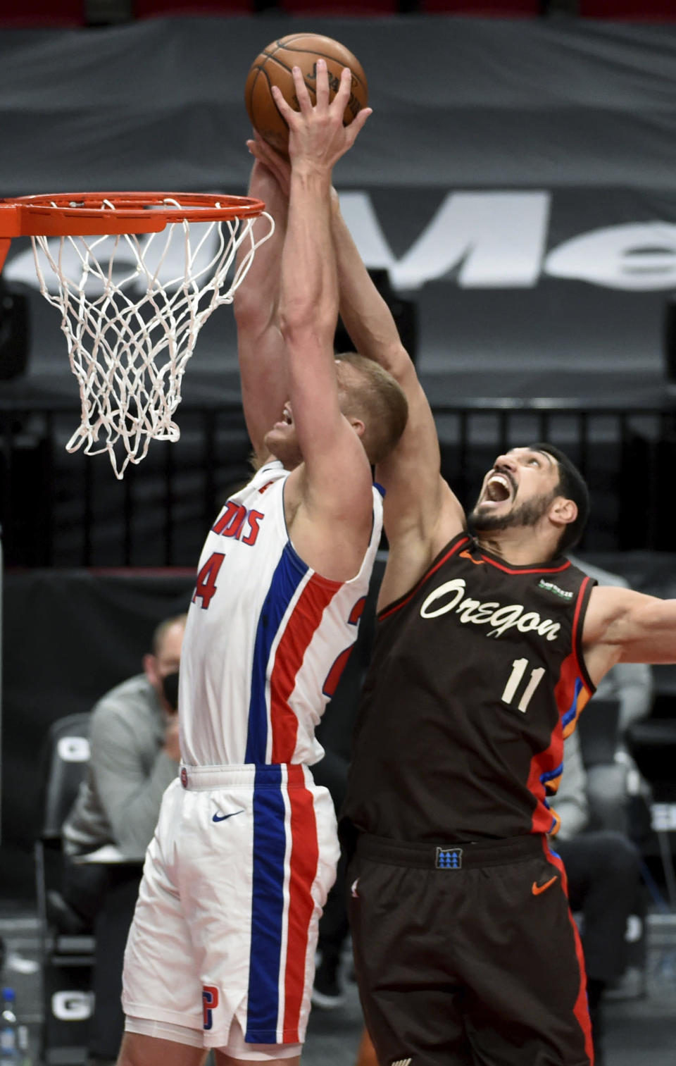 Detroit Pistons center Mason Plumlee, left, and Portland Trail Blazers center Enes Kanter, right go up for a rebound during the first half of an NBA basketball game in Portland, Ore., Saturday, April 10, 2021. (AP Photo/Steve Dykes)