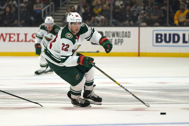 FILE - In this March 7, 2020, file photo, Minnesota Wild left wing Kevin Fiala skates with the puck during the third period of an NHL hockey game against the Los Angeles Kings in Los Angeles. Fiala's emergence as a go-to scorer before the NHL went on hiatus was the best part of the Wild's season so far.(AP Photo/Mark J. Terrill, File)