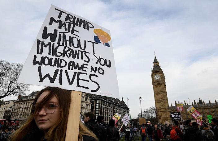 <p>A demonstrator holds a sign during a protest against U.S. President Donald Trump in London, Feb. 20, 2017. (Photo: Toby Melville/Reuters) </p>