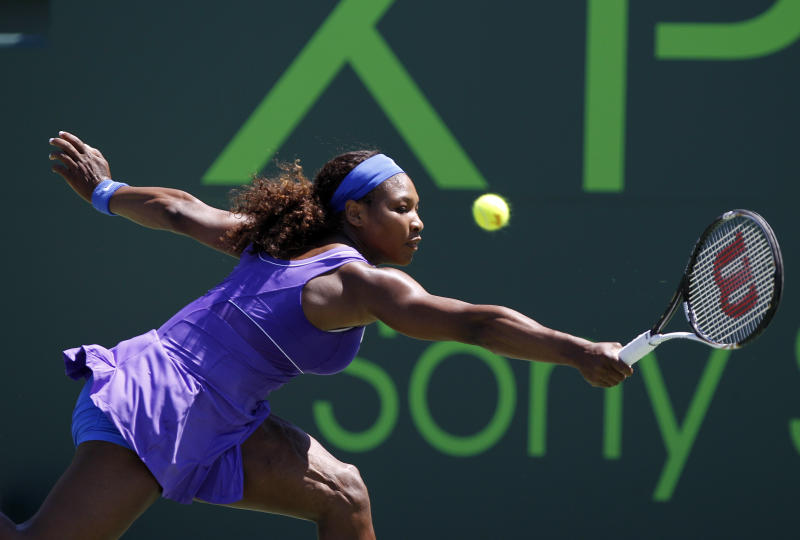 Serena Williams returns the ball to Samantha Stosur, of Australia, during the Sony Ericsson Open tennis tournament, Monday, March 26, 2012, in Key Biscayne, Fla. (AP Photo/Lynne Sladky)