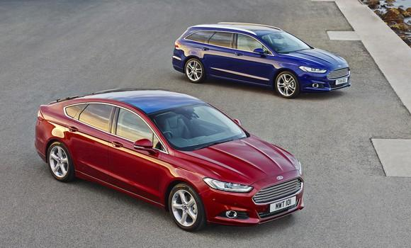 Two Ford Mondeos: A red five-door and a blue station wagon. Aside from the body-style changes, they look almost exactly like the Fusion sedan sold in the United States.