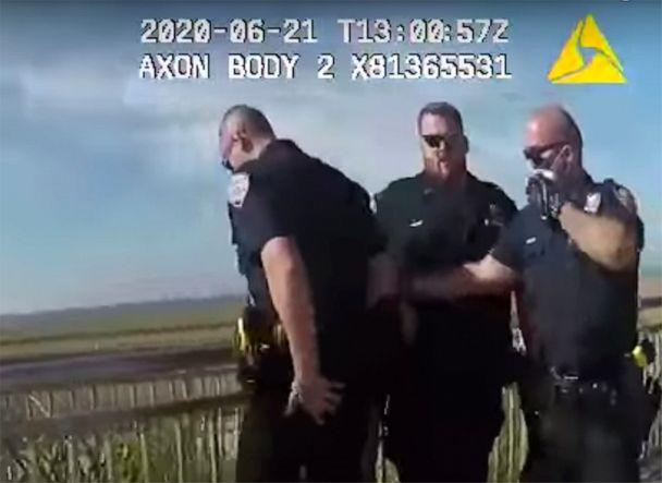 PHOTO: In this photo taken from police body cam video, New York Police officers, including officer David Afanador, right, arrest a man on a boardwalk in New York's Rockaway Beach on Sunday, June 21, 2020. (New York Police Department via AP)