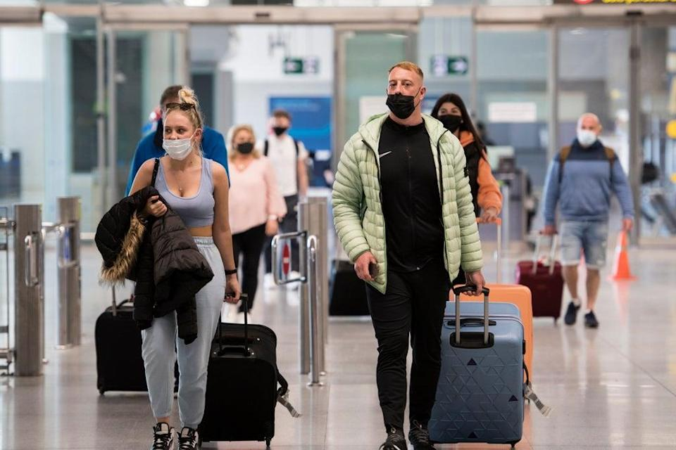 Travellers arrive in Malaga on a flight from London (Getty Images)