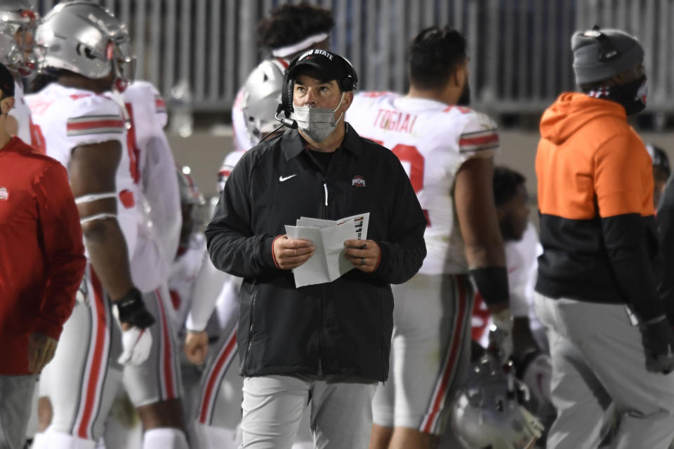 Ohio State coach Ryan Day looks at the scoreboard during the third quarter of the team's NCAA college football game against Penn State in State College, Pa., Saturday, Oct. 31, 2020. Ohio State won 38-25. (AP Photo/Barry Reeger)