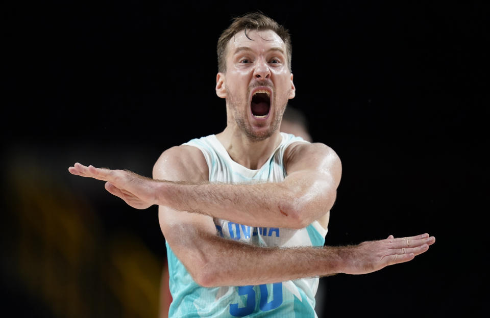 Slovenia's Zoran Dragic (30) celebrates after making a three point basket during men's basketball quarterfinal game against Germany at the 2020 Summer Olympics, Tuesday, Aug. 3, 2021, in Saitama, Japan. (AP Photo/Charlie Neibergall)