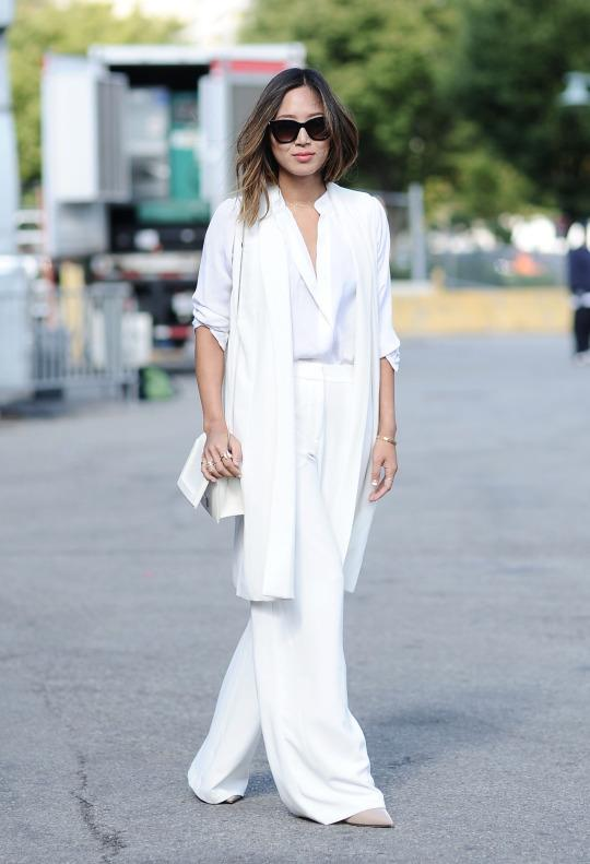 <p>The Song of Style fashion blogger got white on white so right on the streets of New York City.  She also made the case for this season's favorite pant silhouette: the wide-leg.</p>