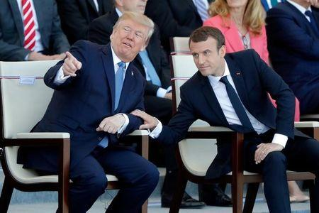 French President Emmanuel Macron and US President Donald Trump attend the traditional Bastille Day military parade on the Champs-Elysees in Paris