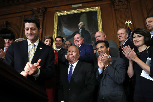 House Speaker Paul Ryan of Wis., left, leads applause for House Ways and Means Chair Rep. Kevin Brady, R-Texas, along with Rep. Carlos Curbelo, R-Fla., and Rep. Cathy McMorris Rodgers, R-Wash., during a news conference following a vote on tax reform on Capitol Hill in Washington, Thursday, Nov. 16, 2017. (AP Photo/Jacquelyn Martin)