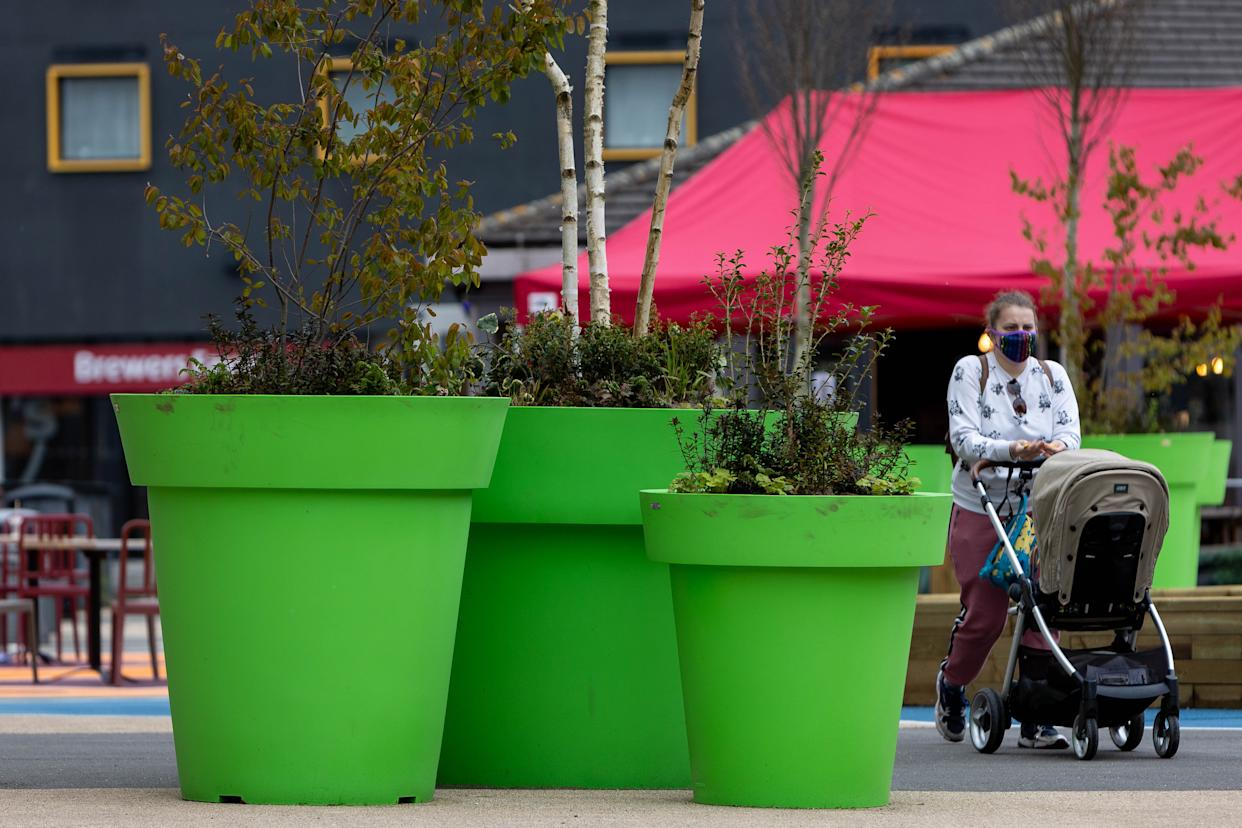 Giant green plant pots at Gallery Sq in Walsall, West Midlands. (SWNS)