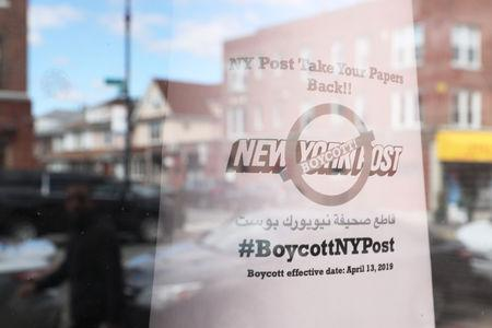 A sign calling for the boycott of the New York Post newspaper is seen in the window of the Yemeni American Merchants Association in the Brooklyn Borough of New York, U.S., April 15, 2019. REUTERS/Shannon Stapleton