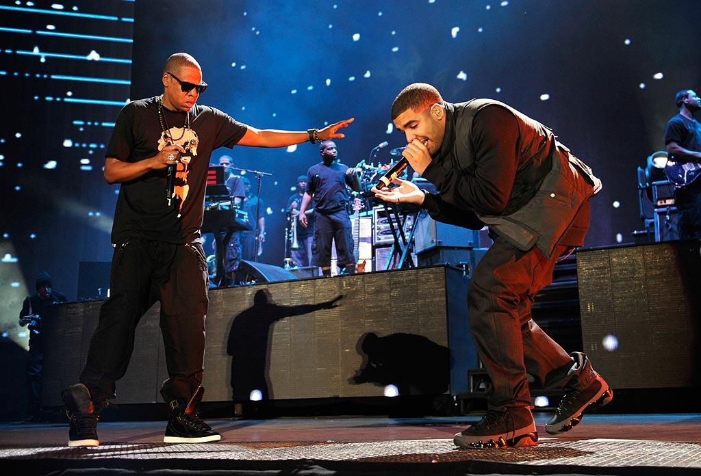 """After kicking off their """"Home and Home"""" tour in Detroit a couple of weeks ago, Jay-Z and Eminem brought the show to New York. Monday marked the first of two concerts at Yankee Stadium -- and it was star-studded. Drake was just one of many hip-hop artists that flew back from the VMAs in Los Angeles to take part in the festivities, joining Jay-Z for performances of """"Miss Me"""" and """"Light Up."""" Kevin Mazur/<a href=""""http://www.wireimage.com"""" target=""""new"""">WireImage.com</a> - September 13, 2010"""