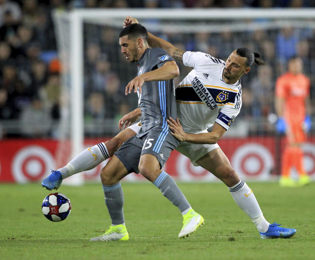 LA Galaxy midfielder Zlatan Ibrahimovic (9) battles for the ball with Minnesota United defender Michael Boxall (15) during the first half of an MLS soccer first-round playoff match, Sunday, Oct. 20, 2019, in St. Paul, Minn. (AP Photo/Andy Clayton-King)