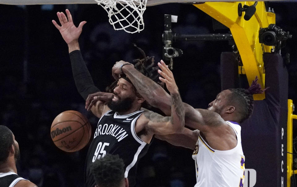 Brooklyn Nets guard DeAndre' Bembry, left, has the ball knocked from his hands by Los Angeles Lakers center Dwight Howard during the first half of a preseason NBA basketball game Sunday, Oct. 3, 2021, in Los Angeles. (AP Photo/Mark J. Terrill)