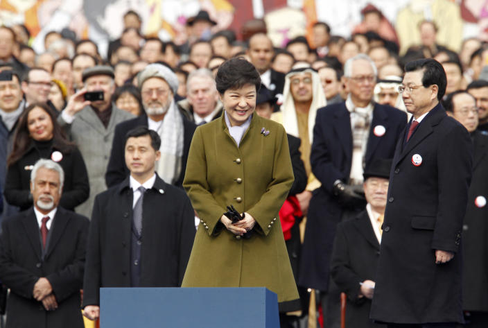 South Korea's new President Park Geun-hye smiles during her inauguration at parliament in Seoul, South Korea, Monday, Feb. 25, 2013. Elected in December, Park is believed to be the first Korean woman to rule in a millennium. (AP Photo/Kim Hong-Ji, Pool)