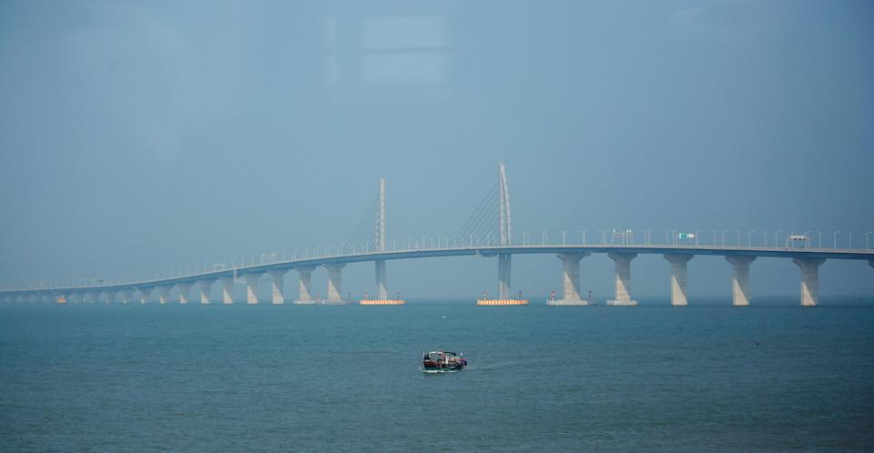 <p>A boat sails in front of the Hong Kong-Zhuhai-Macau Bridge, to be opened in Zhuhai, China March 28, 2018. (REUTERS/Bobby Yip) </p>