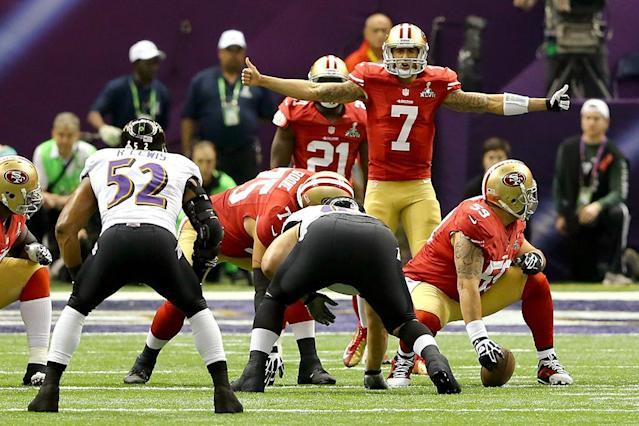 Colin Kaepernick #7 of the San Francisco 49ers signals behind center in the first quarter against the Baltimore Ravens during Super Bowl XLVII at the Mercedes-Benz Superdome on February 3, 2013 in New Orleans, Louisiana. (Photo by Al Bello/Getty Images)