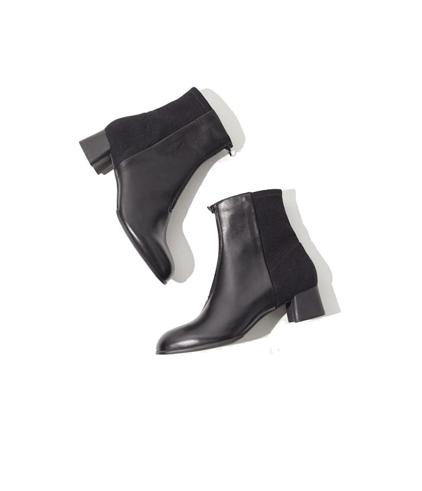 "<p>These two-tone ankle boots have a low block heel for those who love a good boot but hate wearing high heels. You'll wear these booties everywhere: to work, on a date and to dinner. <br /><a rel=""nofollow"" href=""https://fave.co/2SPUwba""><strong>Shop it:</strong></a> $100 (was $190), <a rel=""nofollow"" href=""https://fave.co/2SPUwba"">urbanoutfitters.com</a> </p>"