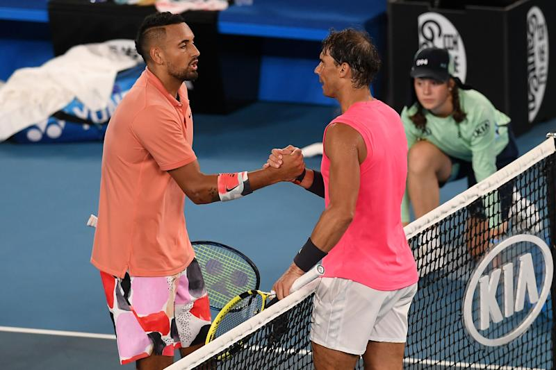 Rafael Nadal (R) shakes hands with Nick Kyrgios at the net.