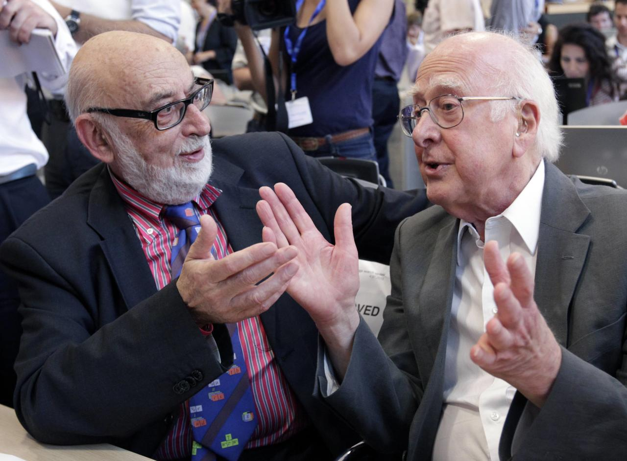 File picture of British physicist Peter Higgs (R) talking with Belgium physicist Francois Englert before a news conference on the search for the Higgs boson at the European Organization for Nuclear Research (CERN) in Meyrin near Geneva July 4, 2012. Britain's Peter Higgs and Belgium's Francois Englert won the 2013 Nobel prize for physics for predicting the existence of the Higgs boson - the particle key to explaining why elementary matter has mass - the award-giving body said October 8, 2013. Picture taken July 12, 2012. REUTERS/Denis Balibouse/Files (SWITZERLAND - Tags: SCIENCE TECHNOLOGY TPX IMAGES OF THE DAY)