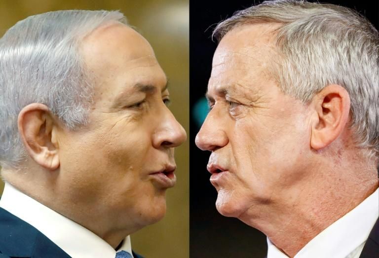Finals poll ahead of Israel's vote pointed to another tight race between Prime Minister Benjamin Netanyahu's right-wing Likud and the centrist Blue and White party, led by ex-military chief Benny Gantz (AFP Photo/RONEN ZVULUN, Jack GUEZ )