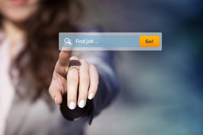 """Women pointing at search window that says """"Find job"""""""