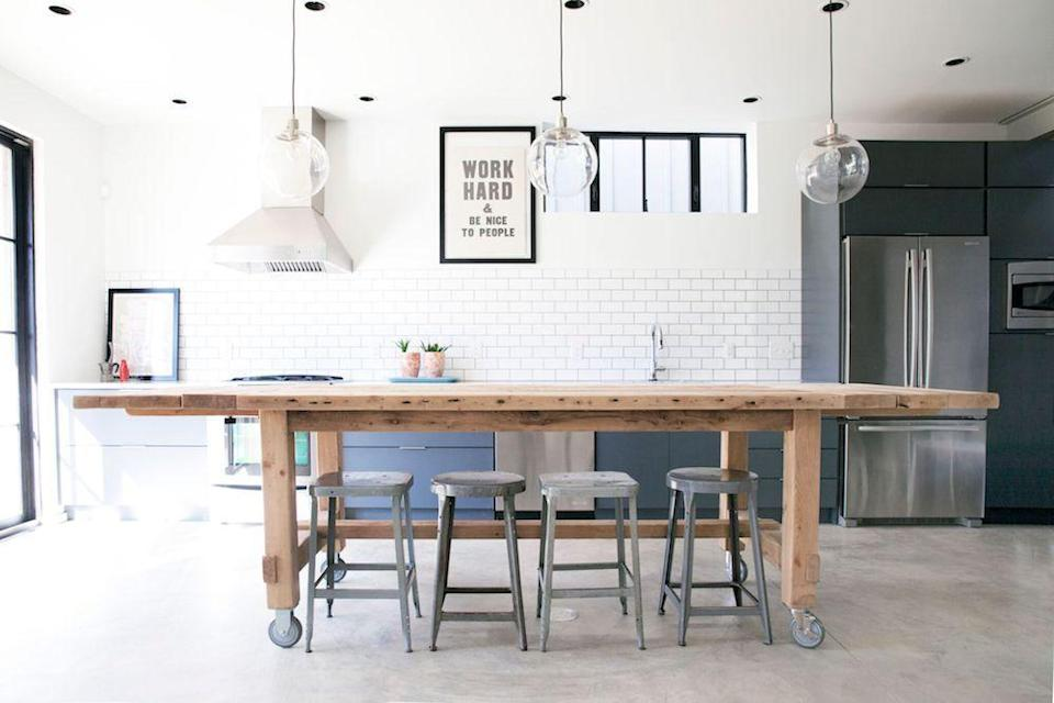 <p>If you live in an industrial, loft-like space, don't try to force another style. Take note from this kitchen designed by Leanne Ford. She embraces the industrial with a large, wood work table on wheels, steel stools, and cement floors. The pendants and subway tiles freshen things up while the painted cabinets ground the room. </p>