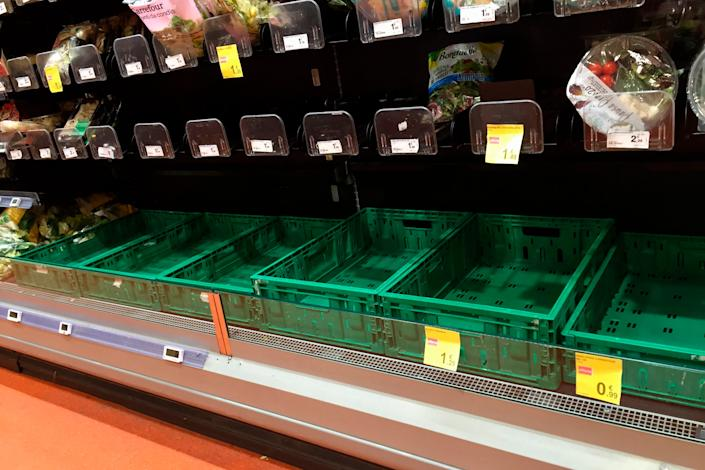 Empty shelves in a supermarket in Milan, Italy on February 23.