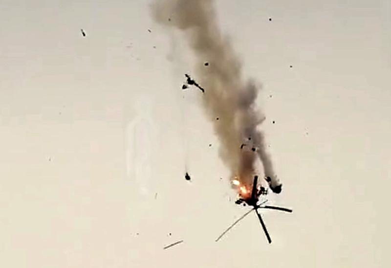 An image grab taken from a video published by jihadists of the Hayat Tahrir al-Sham (HTS) allegedly shows a Syrian military helicopter being downed on February 12, 2020 in Syria's war-torn province of Idlib: Hayat Tahrir al-Sham/AFP via Get
