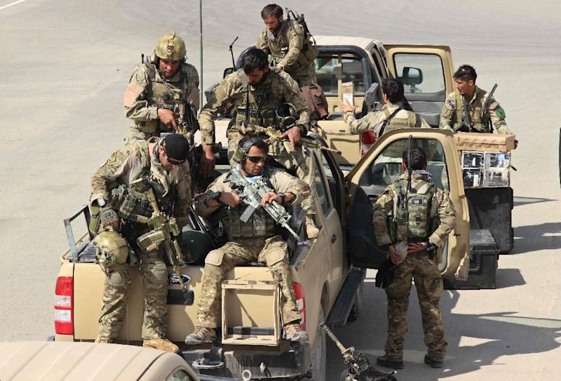 Afghan special forces arrive at the airport as they launch a counteroffensive to retake the city from the Taliban insurgents, in Kunduz, on Septmber 29, 2015