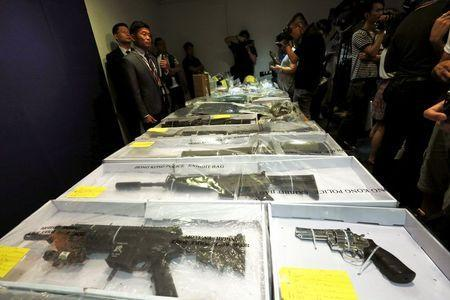 Air rifles seized along with explosives are displayed during a news conference at police headquarters in Hong Kong, China June 15, 2015. REUTERS/Bobby Yip -