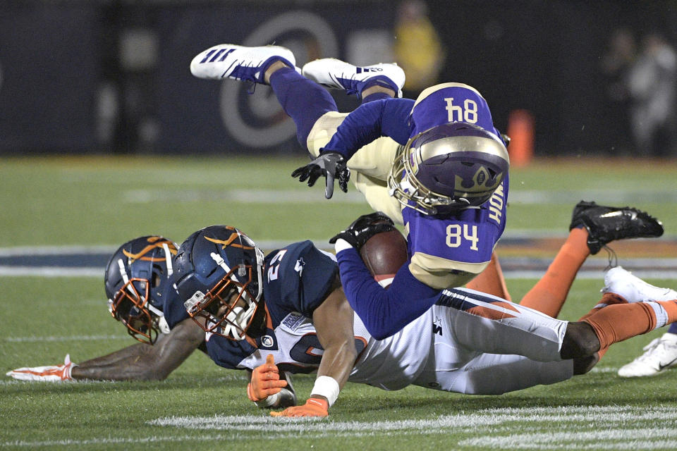 Atlanta Legends receiver Bug Howard (84) is tackled by Orlando Apollos safety Will Hill and defensive back Keith Reaser (29) during an AAF game. (AP)