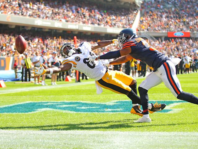 <p>Chicago Bears cornerback Marcus Cooper (31) breaks up a pass intended for Pittsburgh Steelers wide receiver Antonio Brown (84) during the second half at Soldier Field. Chicago won 23-17 in OT. Mandatory Credit: Dennis Wierzbicki-USA TODAY Sports </p>