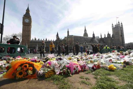 Floral tributes are seen in Parliament Square, following the attack in Westminster earlier in the week, in London
