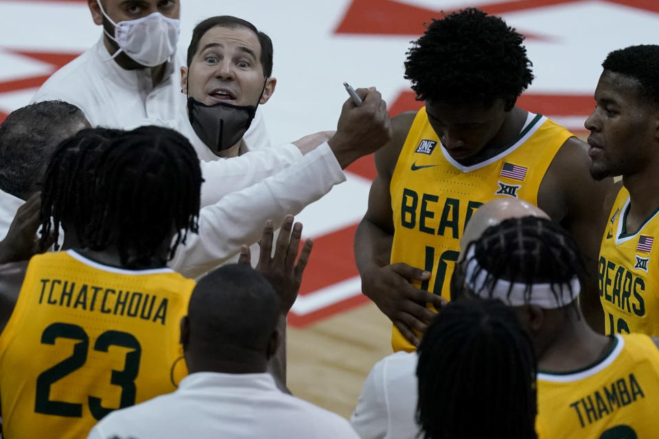 Baylor head coach Scott Drew talks to his team during the second half of an NCAA college basketball game against Oklahoma State in the semifinals of the Big 12 tournament in Kansas City, Mo., Friday, March 12, 2021. (AP Photo/Charlie Riedel)