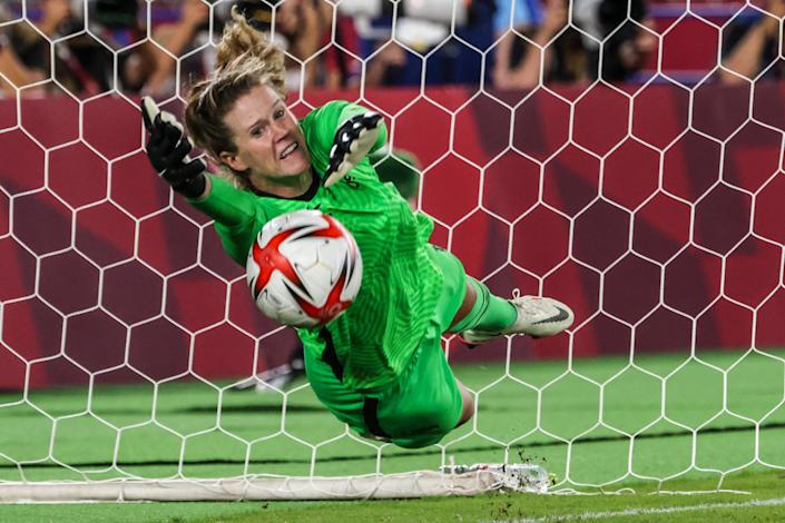 Yokohama, Japan, Friday, July 30, 2021 - Team United States goalkeeper Alyssa Naeher (1) makes a save on the Team Netherlands forward Vivianne Miedema (9), the first of two saves in a shootout victory over Netherlands in the Tokyo 2020 Olympics Womens Football Quarterfinal at International Stadium Yokohama. (Robert Gauthier/Los Angeles Times via Getty Images)
