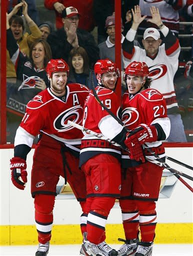 Carolina Hurricanes' Justin Faulk (27) is congratulated on his goal by teammates Jiri Tlusty (19) and Jordan Staal (11) during the second period of an NHL hockey game against the Buffalo Sabres in Raleigh, N.C., Thursday, Jan. 24, 2013. (AP Photo/Karl B DeBlaker)