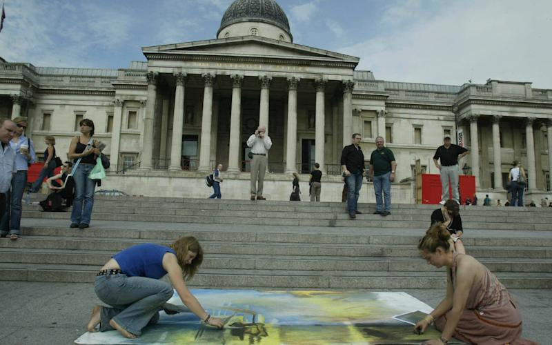 Pavement artists outside the National Gallery in Trafalgar Square, London - Heathcliff O'malley