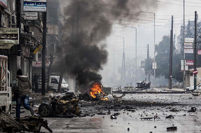 In this Monday, Dec. 17, 2012 photo, a man runs between debris after a mortar shell hit a street killing several people in the Bustan Al-Qasr district of Aleppo, Syria.(AP Photo/Narciso Contreras)