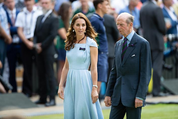 LONDON, ENGLAND - JULY 14:  Catherine, Duchess of Cambridge talks with Prince Edward, Duke of Kent after the trophy presentations of the Mens's Singles Final at The Wimbledon Lawn Tennis Championship at the All England Lawn and Tennis Club at Wimbledon on July 14, 2019 in London, England. (Photo by Simon Bruty/Anychance/Getty Images)