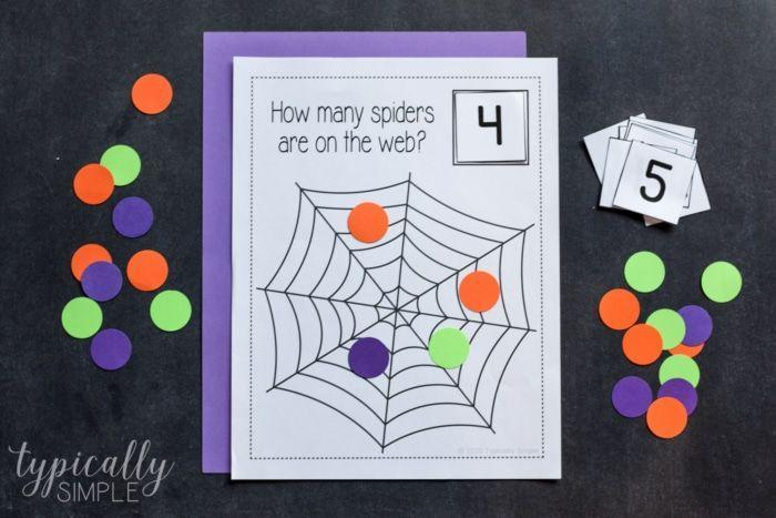"""<p>Kids can pick a number card, place it in the square and then count out how many """"spiders"""" are needed to match the number. A great activity to help them with math! </p><p><a href=""""https://typicallysimple.com/counting-spiders/"""" rel=""""nofollow noopener"""" target=""""_blank"""" data-ylk=""""slk:Get the printable at Typically Simple »"""" class=""""link rapid-noclick-resp""""><em>Get the printable at Typically Simple »</em> </a></p>"""